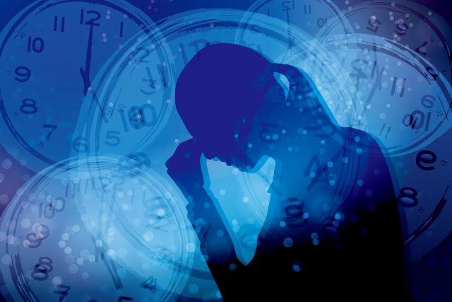 悩む女性の影と複数の時計のイラスト